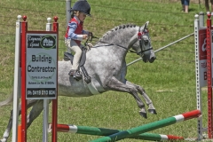 4826 - Sienna Jessop (5) of Bega competes in the Crossrail event on her horse Tye.